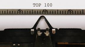 Κείμενο που γράφεται top 100 στον εκλεκτής ποιότητας συγγραφέα από το 1920 το s τύπων Στοκ Φωτογραφία