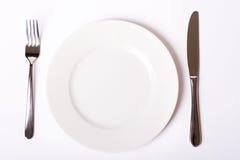 Κενά πιάτο, δίκρανο και μαχαίρι Στοκ Φωτογραφία