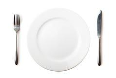 Κενά πιάτο, δίκρανο και μαχαίρι Στοκ Εικόνες