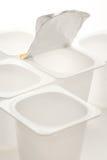 Κενά συντριμμένα πλαστικά δοχεία γιαουρτιού Στοκ εικόνα με δικαίωμα ελεύθερης χρήσης