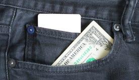 Κενή επαγγελματική κάρτα και ένα δολάριο σε μια τσέπη των gry φθαρμένων τζιν Στοκ εικόνες με δικαίωμα ελεύθερης χρήσης