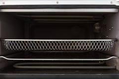 Κενός δίσκος μέσα στην μπροστινή άποψη φούρνων Στοκ Φωτογραφία
