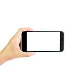 Κενή οθόνη smartphone εκμετάλλευσης χεριών, πορεία ψαλιδίσματος στοκ εικόνα