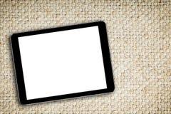 Κενή ψηφιακή ταμπλέτα στο υπόβαθρο υφάσματος στοκ εικόνες