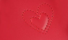 Κεντητική στη μορφή δύο καρδιών που τοποθετείται ο ένας στον άλλο, στην καρφίτσα στοκ φωτογραφία με δικαίωμα ελεύθερης χρήσης