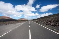 κενός δρόμος Lanzarote τοπίων ηφαι& Στοκ Εικόνα