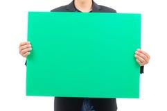 Κενός πράσινος πίνακας εκμετάλλευσης ατόμων Στοκ φωτογραφία με δικαίωμα ελεύθερης χρήσης