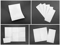 Κενό άσπρο διπλώνοντας ιπτάμενο εγγράφου στο γκρίζο υπόβαθρο Στοκ εικόνα με δικαίωμα ελεύθερης χρήσης