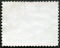 Κενό γραμματόσημο σε ένα μαύρο υπόβαθρο Στοκ Φωτογραφίες