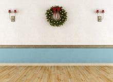 Κενό εκλεκτής ποιότητας δωμάτιο με το στεφάνι Στοκ Φωτογραφίες