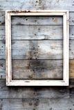 Κενό ξύλινο πλαίσιο σε ένα υπόβαθρο grunge Στοκ Φωτογραφία
