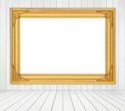 Κενό πλαίσιο στο δωμάτιο με τον άσπρο ξύλινο τοίχο και το ξύλινο backgrou πατωμάτων Στοκ Εικόνες