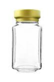 Κενό χρυσό μπουκάλι γυαλιού ΚΑΠ που απομονώνεται στο άσπρο υπόβαθρο στοκ εικόνα