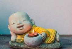 Κερί λαβής αγαλμάτων του Βούδα Στοκ Εικόνες