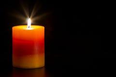 Κερί με τη μαύρη ανασκόπηση στοκ φωτογραφίες