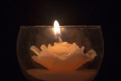 Κερί σε ένα γυαλί Στοκ Εικόνες