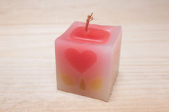 Κερί στο ξύλινο υπόβαθρο Στοκ Εικόνες
