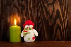 Κερί Χριστουγέννων και παιχνίδι χιονανθρώπων Στοκ Εικόνα