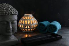 Κερί Buddah witn και towel spa έννοια Στοκ εικόνα με δικαίωμα ελεύθερης χρήσης