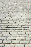 Κεραμωμένος με το τεμάχιο της πορείας τούβλων πετρών επίστρωσης ως αφηρημένο υπόβαθρο στοκ φωτογραφίες