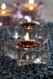 Κεριά στο μπλε χαλί Στοκ εικόνα με δικαίωμα ελεύθερης χρήσης