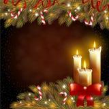 Κεριά Χριστουγέννων και ένα δέντρο έλατου Στοκ Εικόνες