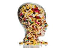 Κεφάλι φιαγμένο από γυαλί με τις ταμπλέτες Στοκ φωτογραφία με δικαίωμα ελεύθερης χρήσης