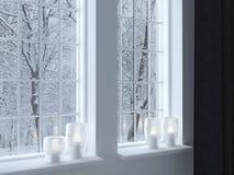 Κηροπήγια σε ένα windowsill Στοκ Εικόνες