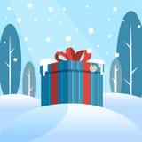 Κιβώτιο με ένα δώρο στο χιόνι ελεύθερη απεικόνιση δικαιώματος
