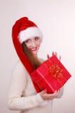 Κιβώτιο δώρων εκμετάλλευσης γυναικών στενός κόκκινος χρόνος Χριστουγέννων ανασκόπησης επάνω Στοκ Εικόνες