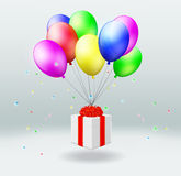 Κιβώτιο δώρων με τις μύγες στα μπαλόνια Στοκ Φωτογραφία
