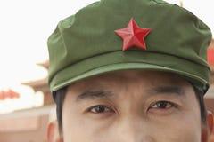 Κινέζος κομμουνιστής Solider που φορά το καπέλο με ένα αστέρι, κινηματογράφηση σε πρώτο πλάνο Στοκ Φωτογραφίες