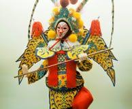 Κινεζικό παιχνίδι από την παραδοσιακή όπερα της Κίνας Ομοίωμα στο ζωηρόχρωμο ύφασμα Στοκ φωτογραφία με δικαίωμα ελεύθερης χρήσης