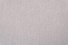 Κινηματογράφηση σε πρώτο πλάνο ενός ελαφριού μπεζ σχεδίου υφάσματος ψαροκόκκαλων για λόγους υποβάθρου Στοκ εικόνες με δικαίωμα ελεύθερης χρήσης