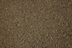 Κινηματογράφηση σε πρώτο πλάνο της ασφάλτου με το αμμοχάλικο που παρεμβάλλεται σε το στοκ εικόνες με δικαίωμα ελεύθερης χρήσης
