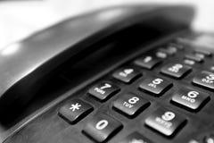 Κινηματογράφηση σε πρώτο πλάνο της ρύθμισης των κουμπιών ψηφίων ενός τηλεφώνου στοκ εικόνα