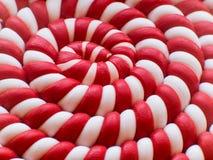 Κινηματογράφηση σε πρώτο πλάνο του άσπρου και κόκκινου σπειροειδούς υποβάθρου lollipop Σπειροειδής ανασκόπηση Στοκ Εικόνες