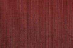 Κινηματογράφηση σε πρώτο πλάνο του κόκκινου, κάθετου ευθυγραμμισμένου, υφαντικού τοίχου fabr Στοκ εικόνες με δικαίωμα ελεύθερης χρήσης