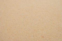 Κινηματογράφηση σε πρώτο πλάνο του σχεδίου υποβάθρου άμμου μιας παραλίας το καλοκαίρι Στοκ εικόνα με δικαίωμα ελεύθερης χρήσης