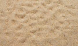 Κινηματογράφηση σε πρώτο πλάνο του σχεδίου υποβάθρου άμμου μιας παραλίας το καλοκαίρι Στοκ Φωτογραφίες