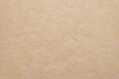 Κινηματογράφηση σε πρώτο πλάνο του σχεδίου υποβάθρου άμμου μιας παραλίας το καλοκαίρι Στοκ φωτογραφία με δικαίωμα ελεύθερης χρήσης