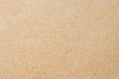 Κινηματογράφηση σε πρώτο πλάνο του σχεδίου υποβάθρου άμμου μιας παραλίας το καλοκαίρι Στοκ Εικόνες