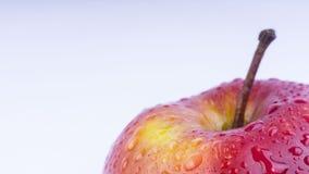 Κινηματογράφηση σε πρώτο πλάνο των φρούτων μήλων στο άσπρο υπόβαθρο Στοκ Φωτογραφία