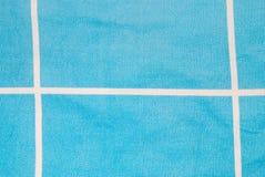 Κινηματογράφηση σε πρώτο πλάνο στην άσπρη γραμμή με το μπλε υπόβαθρο υφάσματος Στοκ Εικόνα