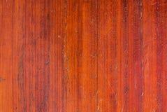 Κινηματογράφηση σε πρώτο πλάνο στην πορτοκαλιά κάθετη ξύλινη σύσταση υποβάθρου Στοκ Εικόνα