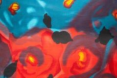 Κινηματογράφηση σε πρώτο πλάνο στην τέχνη που τυπώνεται στο υπόβαθρο υφάσματος Στοκ Εικόνα