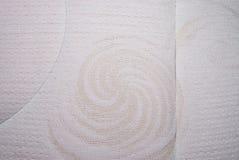 Κινηματογράφηση σε πρώτο πλάνο στη μορφή σαλιγκαριών στο άσπρο υπόβαθρο υφάσματος Στοκ Εικόνες