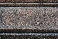 Κινηματογράφηση σε πρώτο πλάνο στο βρώμικο μικρό πέτρινο υπόβαθρο πατωμάτων Στοκ Φωτογραφία