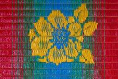 Κινηματογράφηση σε πρώτο πλάνο στο όμορφο υπόβαθρο χαλιών λουλουδιών υφαίνοντας Στοκ Εικόνα