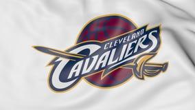 Κινηματογράφηση σε πρώτο πλάνο της κυματίζοντας σημαίας με το λογότυπο ομάδα μπάσκετ των Cleveland Cavaliers ΝΒΑ, τρισδιάστατη απ απεικόνιση αποθεμάτων